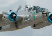 b 25 airplane featured at the laporte air show with antique cars